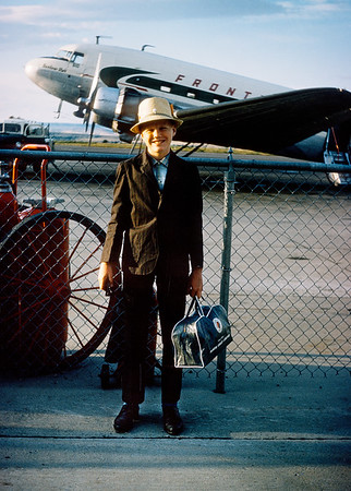 This is the first flight I can remember. My grandmother snapped this slide as she was putting me on an old DC-3 in Billings Montana back in 1965. I believe the destination was Salt Lake. I remember worrying about crashing right after fastening my seat belt. Something that still crosses my mind every time I get on a plane.