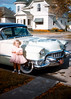 A young girl, probably Judy, beside a white chrome-mobile. Hazel enjoyed putting cars in her pictures. The cars of her day were more photogenic than the, they all look alike, aerodynamic bubbles on the road today.