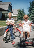 Hazel snapped this shot of me and my sister on the sidewalk in front of our paternal grandparent's home in Livingston Montana sometime in August of 1959. The original Kodachrome slide is typically high contrast with well-preserved colors. Shooting partially backlit faces in full sunlight with this film usually resulted in what I call Kodachrome eyes: dark pits with little shadow detail.