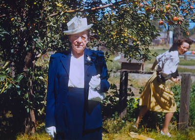 My greatgrandmother Minnie Raver posing in a blue dress on her 65th birthday.  This is a rare old Kodachrome slide that I can precisely date: August 22, 1946. The woman running to get out of the picture in the background is probably one of my great aunts. As I've noted before photobombing was invented long before there was a word for it.