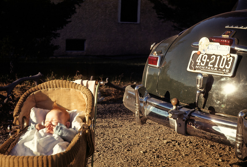 A baby sleeping by the bumper of my grandparent's car in the summer of 1948.  The colors in this sixty year old Kodachrome slide are bright and clear.  It's an odd combination but the light that caught my grandmother's eye still lives.