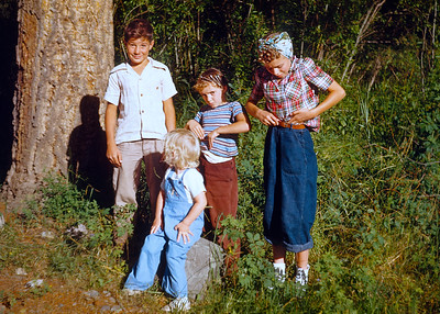 One of Hazel's group of kids shots. Here we have Earl, the boy on the left, my aunt Alberta in the middle, my mother in the red plaid shirt on the right and blond toddler Judy sitting in front. Taken sometime in the warm months of 1950.  Alberta and Judy are still alive (June 2019). My mother died six years ago and I don't know if Earl is still alive.