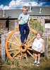 Me and my sister Aileen with a wagon wheel. Hazel composed some very nice shots and this is one of her best.