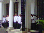 Cabinet officials wait for the remains of Secretary Robredo in Malacanang.