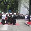 Honorary pallbearers surrounding remains of Secretary Robredo