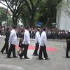 DOTC Secretary Mar Roxas with cabinet officials and Robredo family following Secretary Robredo's remains