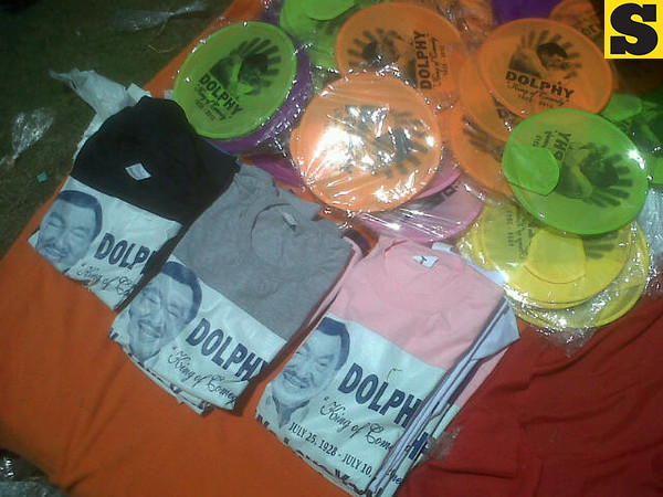 Shirts and fans bearing Dolphy's image are being sold Sunday at the Heritage Park, Taguig. (Virgil Lopez/Sunnex)