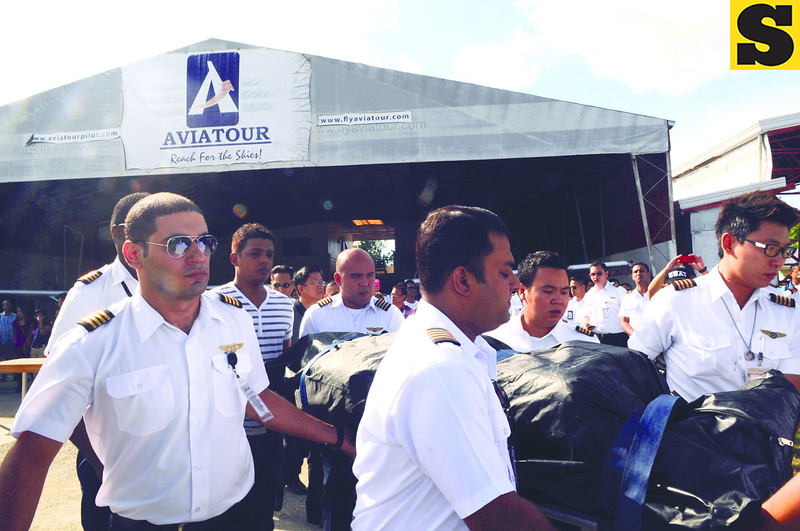 The body of Aviatour CEO and chairman Captain Jessup Bahinting arrived Thursday at the Mactan-Cebu International Airport from Masbate. His body was retrieved on Wednesday, August 22, 2012, inside the fuselage of the Piper Seneca that crashed off Masbate. Carrying his remains in this photo are student pilots. (Allan Cuizon)