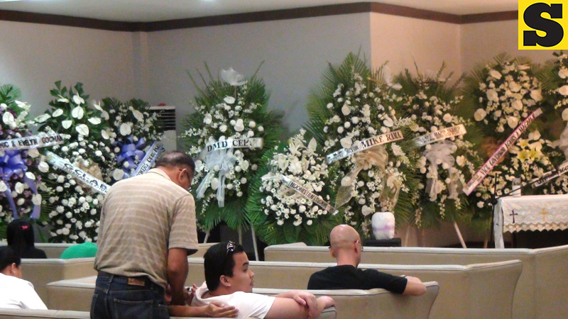 Close friends and relatives of Captain Jessup Bahinting started to flock to St. Peter's Funeral Homes in Cebu City for the wake of the pilot who died in a plane crash in Masbate. (Sunnex)