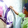 YOU SAVED MY LIFE.  Assistant Cebu City zookeeper Ronaldo Aventurado leaves a thank you note on a tarpaulin message board in honor of Capt. Jessup Bahinting. The captain saved Aventurado's life by lending a Cessna that flew to Cebu some antivenom from Camiguin, after a cobra bit the zookeeper's hand. (Sun.Star Photo/Ruel Rosello)