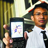 JOURNEY'S END. Misael Christian Pardamean, an Indonesian flight student, shows a photo of him and Kshitiz Chand, whose remains were flown to Kathmandu, Nepal on Sunday. (Allan Cuizon)