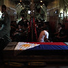 The casket, with the Philippine flag, containing the remains of Sec. Jesse Robredo on board C130 plane Tuesday, August 21, 2012. The casket is to be brought to Naga City in Bicol province, his hometown, where the family of the Secretary is waiiting. (Malacanang Photo Bureau)