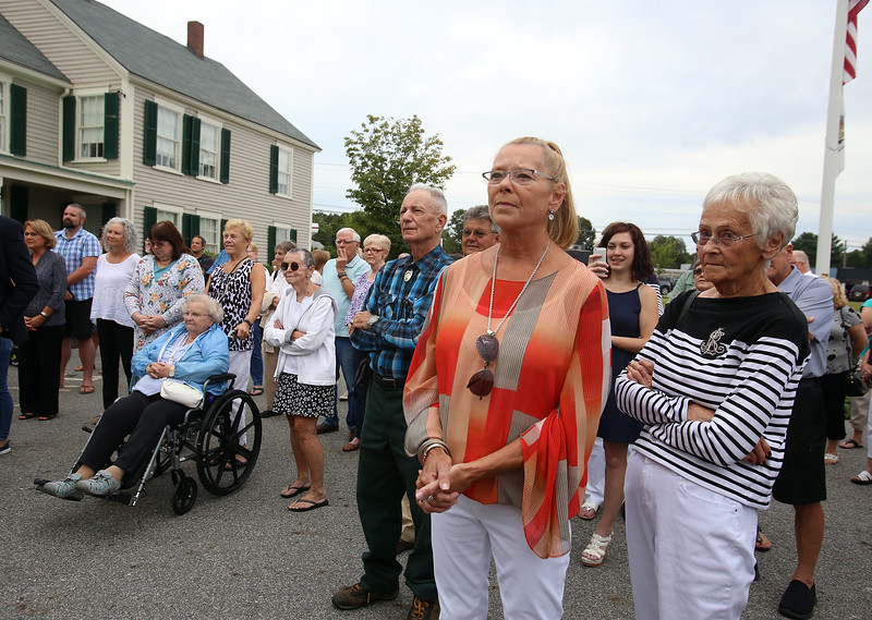 Dedication of Harvey J. Gagnon Harmony Hall. Jean Kendall of Dracut, right, one of Harvey Gagnon's sisters, and her daughter Catherine McCarthy-Carson of Pelham, N.H., listen to speakers. (SUN/Julia Malakie)
