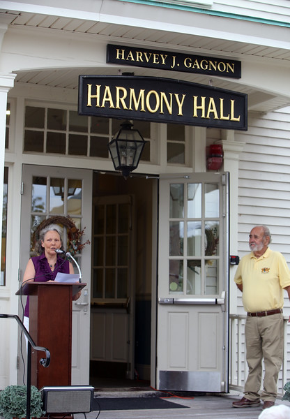 Dedication of Harvey J. Gagnon Harmony Gagnon's daughter Leslie Cox of Dracut speaks as Dracut Historical Society chairman David Paquin looks on. (SUN/Julia Malakie)