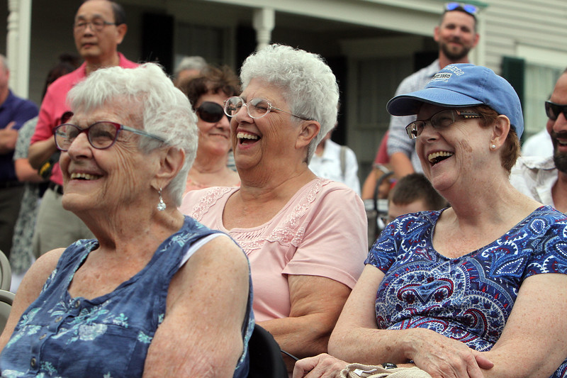 Dedication of Harvey J. Gagnon Harmony Hall. From left, Dracut Historical Society members Rev. Sylvia Robinson and Jacqueline Chausse of Dracut, and Joanna Harris of Dracut, a member of ACTORS inc , which uses Harmony Hall, laugh at a story about Harvey. (SUN/Julia Malakie)