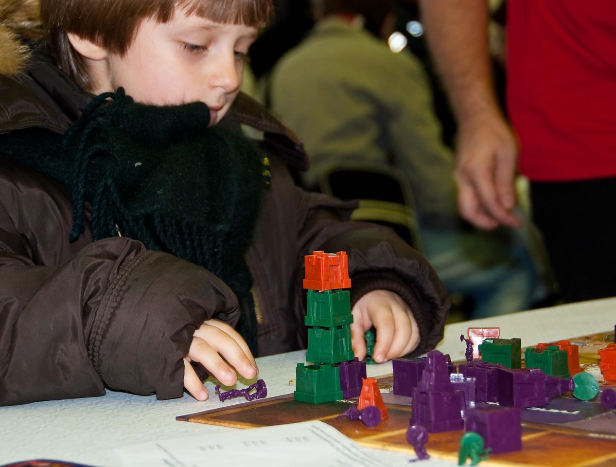 Boy, playing tabletop game at Igromir 2009