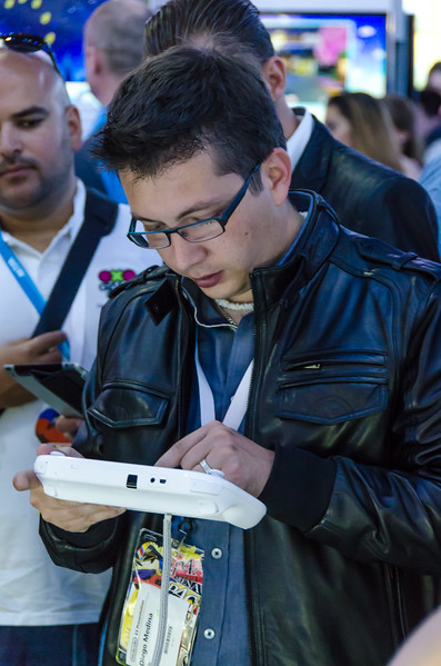 Gamer with Wii U controller at E3 2012