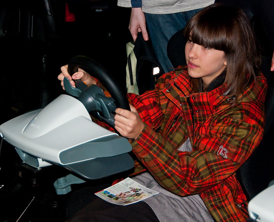 Girl, playing Forza 3 at Igromir 2009