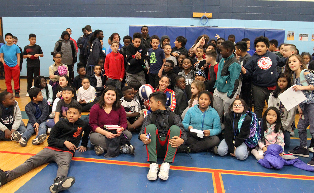 ". Harlem Globetrotter player Briana ""Hoops\"" Green poses for a group photo during her visit to the Boys & Girls Club of Greater Lowell to talk about the T.E.A.M. Up at School anti-bullying program, which stands for Talk, Empathize, Ask and Mobilize.  (SUN/Julia Malakie)"