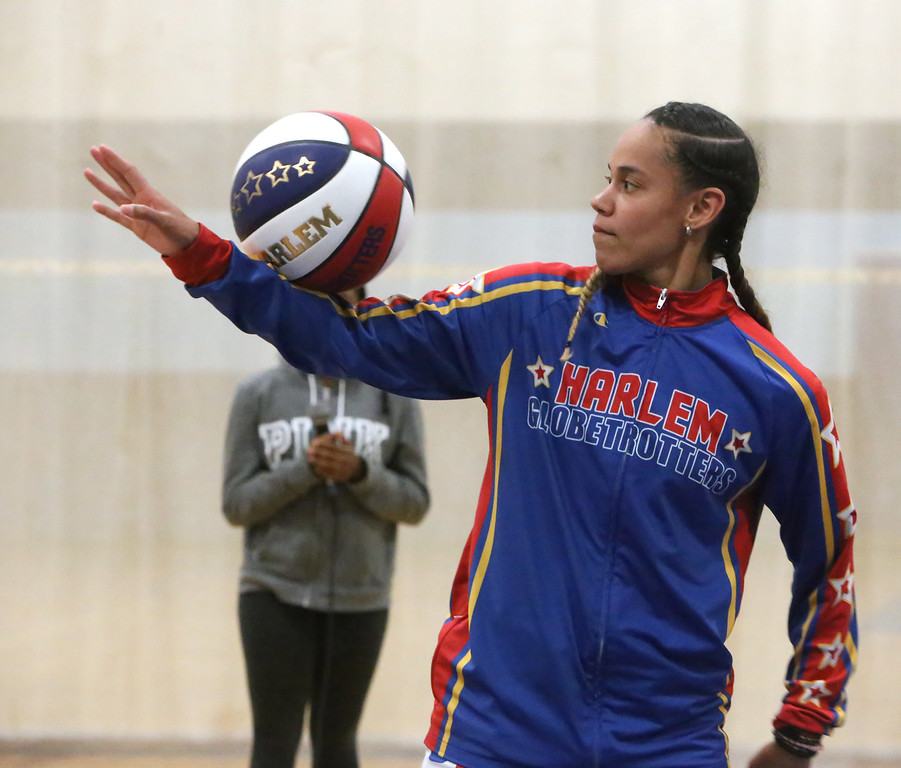 ". Harlem Globetrotter player Briana ""Hoops\"" Green demonstrates some moves during a visiti to the Boys & Girls Club of Greater Lowell to talk about the T.E.A.M. Up at School anti-bullying program, which stands for Talk, Empathize, Ask and Mobilize.  (SUN/Julia Malakie)"