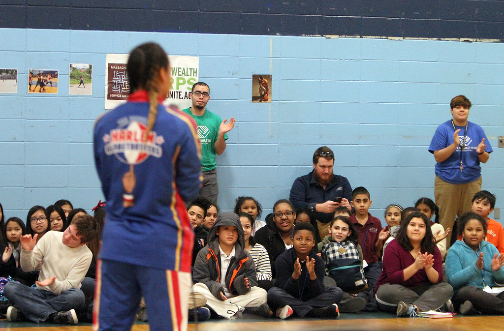 ". Harlem Globetrotter player Briana ""Hoops\"" Green visits the Boys & Girls Club of Greater Lowell to talk about the T.E.A.M. Up at School anti-bullying program, which stands for Talk, Empathize, Ask and Mobilize.  (SUN/Julia Malakie)"