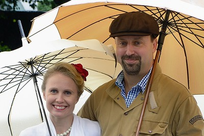 Couple under Brollies at the Goodwood Revival 2016