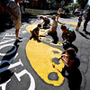 "Greg Mulligan, standing left, looks over the progress of the Paint the Pavement project.<br /> Members of the Goss Grove Neighborhood Association spent much of Sunday painting the pavement at the intersection of 19th Street and Goss in Boulder.<br /> For more photos and a video, go to  <a href=""http://www.dailycamera.com"">http://www.dailycamera.com</a>.<br /> Cliff Grassmick / September 25, 2011"