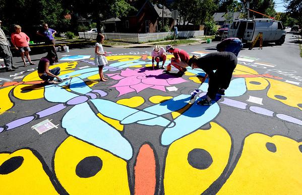 "Artist, Jan Burch, bottom right, and other volunteers get close to completing their Paint the Pavement art project.<br /> Members of the Goss Grove Neighborhood Association spent much of Sunday painting the pavement at the intersection of 19th Street and Goss in Boulder.<br /> For more photos and a video, go to  <a href=""http://www.dailycamera.com"">http://www.dailycamera.com</a>.<br /> Cliff Grassmick / September 25, 2011"