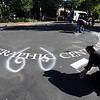 "Artist, Jan Burch, bottom right, and other volunteers begin mapping out their Paint the Pavement art project.<br /> Members of the Goss Grove Neighborhood Association spent much of Sunday painting the pavement at the intersection of 19th Street and Goss in Boulder.<br /> For more photos and a video, go to  <a href=""http://www.dailycamera.com"">http://www.dailycamera.com</a>.<br /> Cliff Grassmick / September 25, 2011"
