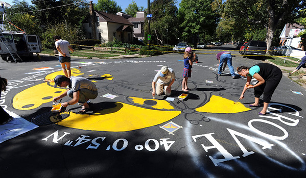 "Greg Mears,  bottom left, and Gina Martinez-Stranski, bottom right, were among about a dozen volunteers that worked on the Paint the Pavement project.<br /> Members of the Goss Grove Neighborhood Association spent much of Sunday painting the pavement at the intersection of 19th Street and Goss in Boulder.<br /> For more photos and a video, go to  <a href=""http://www.dailycamera.com"">http://www.dailycamera.com</a>.<br /> Cliff Grassmick / September 25, 2011"