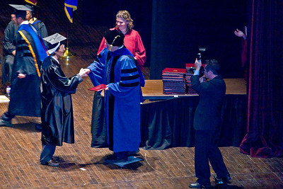 Byung-Dong Pak, receiving congratulations and B.A. degree from dean James A. Parente, Jr.