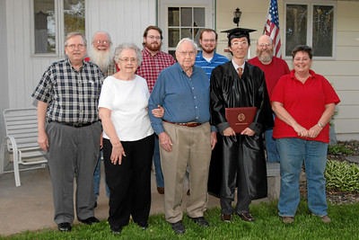 Byung-Dong Pak, celebrating graduation with United States (sort of) adopted family.  Front, Left-to-Right: David Englund (UofMN graduate, class of 1996), Betty Englund, Roland Englund, Byung-Dong Pak, Bonnie Clark. Back, Left-to-Right: Terry Englund, Caleb Clark, Aaron Clark, Rick Clark.