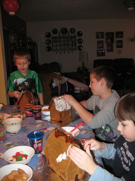 Jakob, Andrew, and Rufio decorating their Gingerbread houses.