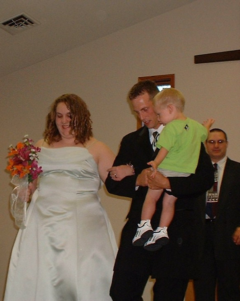 """Jason and Andrew after the ceremony.  As the flower girl was walking down the aisle dropping flower petals, Andrew pointed at her and said out loud...  """"She's making a mess""""."""