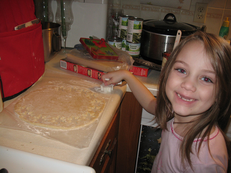 Guinevere helping Oma make Christmas pies.