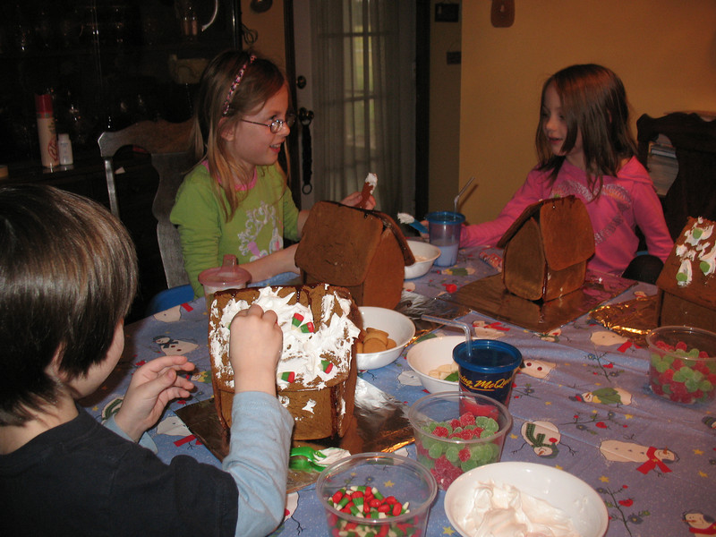 Rufio, Stormy, and Guinevere decorating their Gingerbread houses