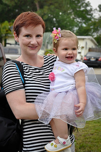 Mommy and daughter going to a birthday party.
