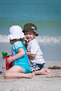 Henry and Claire in the sun by the surf.