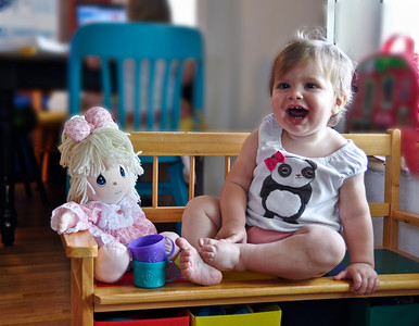 Matilda happy with her doll.
