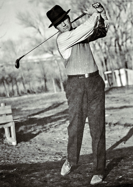 My paternal grandfather Frank Baker senior swinging a golf club. Frank was an excellent golfer in his prime. He maintained a low handicap until Buerger's disease and small strokes reduced his abilities. I am not sure when this picture was taken. Again people would a few dates on the back of photos kill you!  Frank looks like he's in his early sixties or late fifties here giving an approximate year of 1958. This picture is a re-photographed large print that I inherited when I started sorting through my deceased mother's family photographs. The print does not fit in my flatbed scanner so I took a few shots with my macro lens. I could probably get a better result by flatbed scanning the image in parts and reassembling it digitally but that's more work than this image merits.