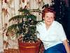 Hazel beside a  small Christmas tree.
