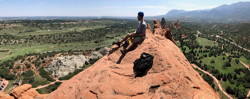 [Panorama shot here.] .. Victory!  .. On top of the Garden of the Gods  at 1:00 pm - all to ourselves and the angels.