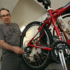 Doug Browne of Groton, who repairs used bikes and donates them to the Boys & Girls Club of Greater Lowell and the Nashua Soup Kitchen. This Schwinn SX2000 is bike #390. (SUN/Julia Malakie)