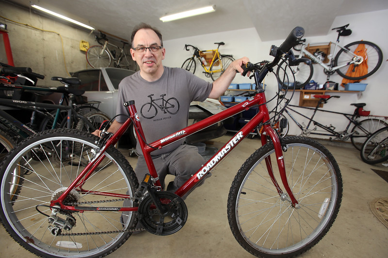 Doug Browne of Groton, who repairs used bikes and donates them to the Boys & Girls Club of Greater Lowell and the Nashua Soup Kitchen. This Roadmaster is bike #589. (SUN/Julia Malakie)