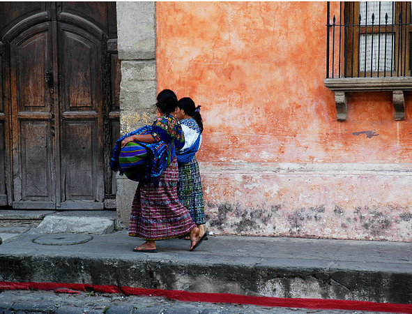 Friends strolling Antigua Guatemela's colorful streets  ©Gerald Diamond All rights reserved