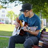 Frank Benid from Pepperell enjoys the weather on Townsend Common while playing his guitar on Tuesday afternoon.  SENTINEL & ENTERPRISE/JOHN LOVE