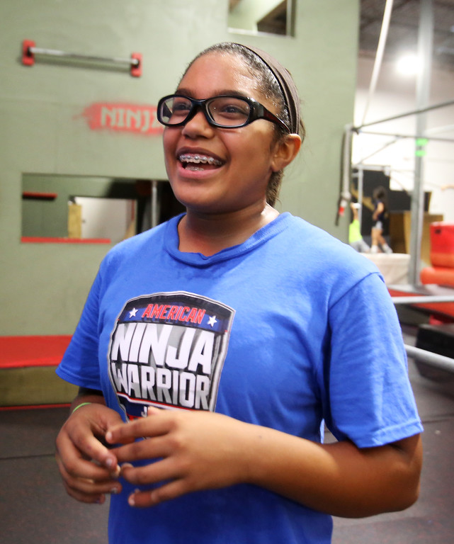 . Analise Grady, 14, of Billerica, who participated in American Ninja Warrior Jr., works out at Gymja Warrior in Woburn. (SUN/Julia Malakie)
