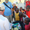Handing out toys to children at Mission of Hope.