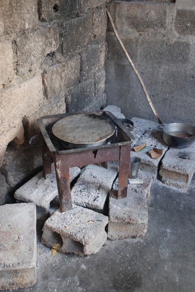The stove has been moved outside! This is good news, as last time I visited, in March, they were cooking inside over the coals, which is very hot, and hazardous to their health.