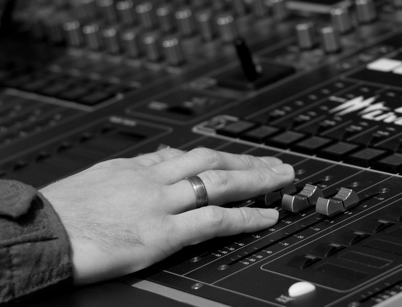 Hand on a mixing board